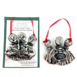 pewter carol singers ltd edition christmas decoration on and off presentation card with red ribbon
